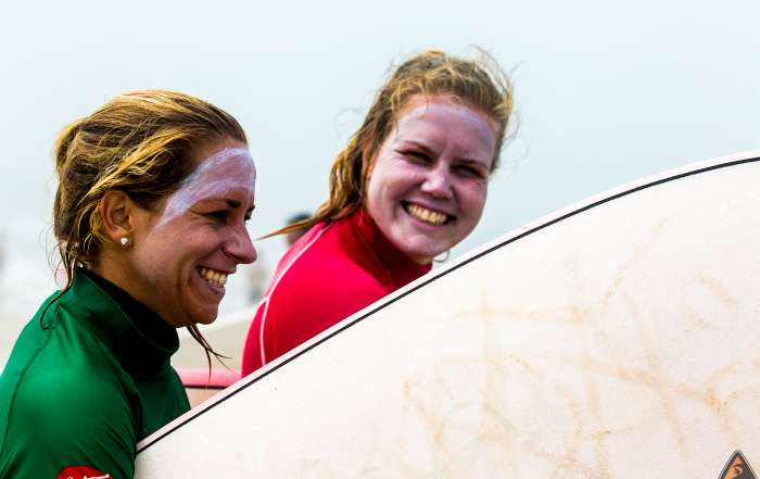 girls surf smiles