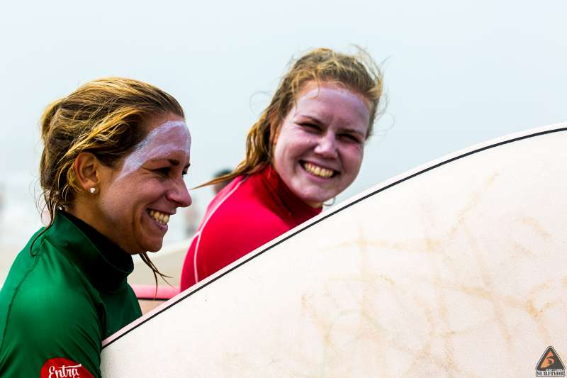 girls surf smiles