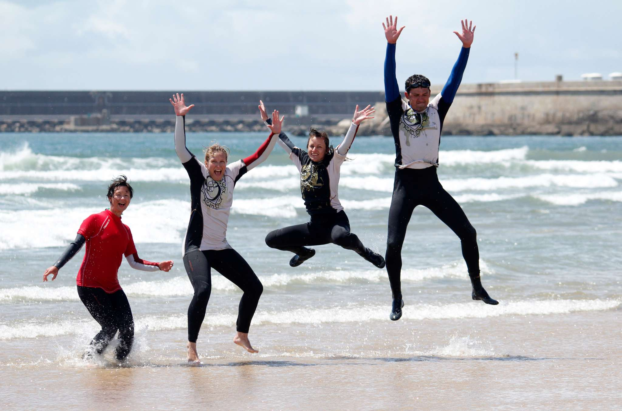 Surfers Jump for Joy